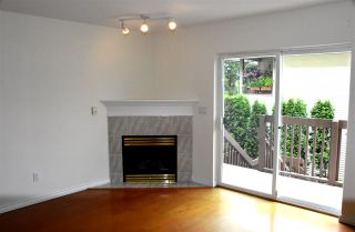 Photo 3: 107 19700 56 Avenue in Langley: Langley City Townhouse for sale : MLS®# R2515473