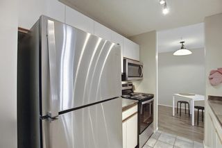 Photo 12: 207 33 Arbour Grove Close NW in Calgary: Arbour Lake Apartment for sale : MLS®# A1135288