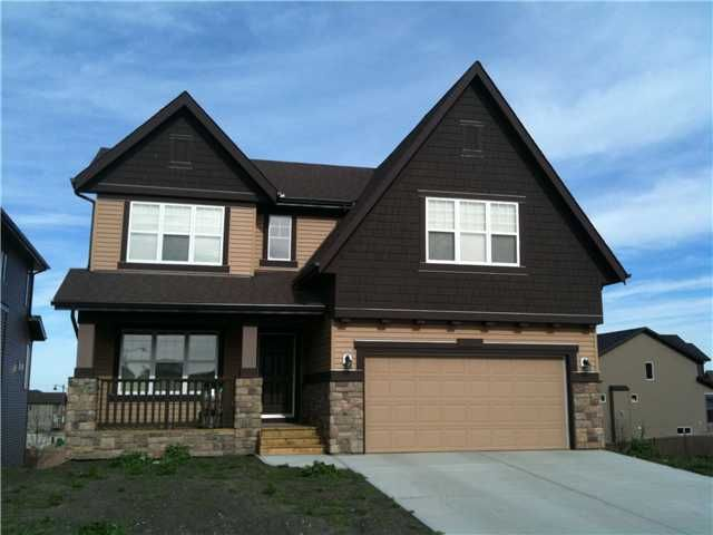 This one year old home has quick possession.  Walk-out basement (undeveloped) with view of Fish Creek Park from main and upper levels