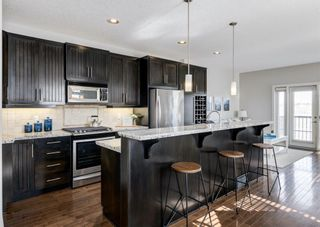 Photo 4: 106 1312 Russell Road NE in Calgary: Renfrew Row/Townhouse for sale : MLS®# A1080835
