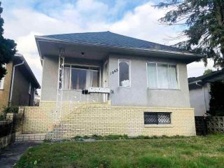 Photo 1: 1065 E 56TH Avenue in Vancouver: South Vancouver House for sale (Vancouver East)  : MLS®# R2574274