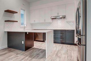Photo 8: 2 137 24 Avenue NE in Calgary: Tuxedo Park Row/Townhouse for sale : MLS®# C4278414