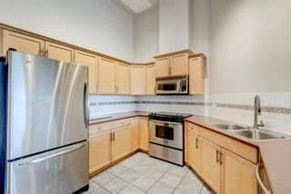 Photo 5: 504 2411 Erlton Road SW in Calgary: Erlton Apartment for sale : MLS®# A1105193