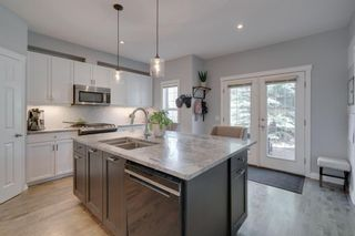 Photo 4: 52 Scarpe Drive SW in Calgary: Garrison Woods Row/Townhouse for sale : MLS®# A1128350