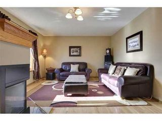 Photo 3: 4 HAULTAIN Place SW in Calgary: Bungalow for sale : MLS®# C3545547