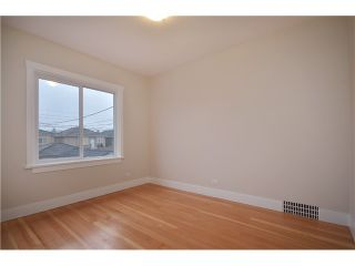 Photo 7: 4847 HENRY Street in Vancouver: Knight House for sale (Vancouver East)  : MLS®# V996847