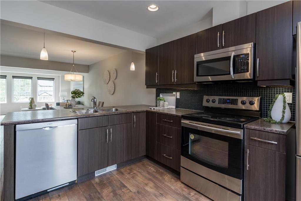 Photo 8: Photos: 104 15 Bridgeland Drive in Winnipeg: Bridgwater Forest Condominium for sale (1R)  : MLS®# 202115646