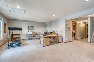 Photo 32: 210 Arbour Cliff Close NW in Calgary: Arbour Lake Semi Detached for sale : MLS®# A1086025