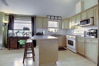 Photo 9: 408 128 CENTRE Avenue: Cochrane Apartment for sale : MLS®# C4295845