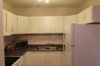 Photo 3: 105 36 GLENBROOK Crescent: Cochrane Apartment for sale : MLS®# A1028403