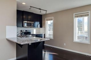 Photo 5: 1402 Auburn Bay Square SE in Calgary: Auburn Bay Row/Townhouse for sale : MLS®# A1103124