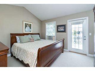 """Photo 11: 7033 179A Street in Surrey: Cloverdale BC Condo for sale in """"Provinceton"""" (Cloverdale)  : MLS®# R2392761"""