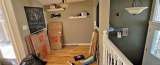 Photo 4: 11228 Braeside Drive SW in Calgary: Braeside Detached for sale : MLS®# A1148483