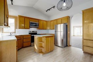Photo 2: 24 SIGNATURE Way SW in Calgary: Signal Hill Detached for sale : MLS®# C4302567