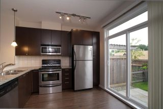 "Photo 1: 138 18777 68A Avenue in Surrey: Clayton Townhouse for sale in ""COMPASS"" (Cloverdale)  : MLS®# R2419589"