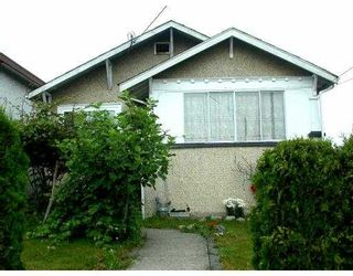 Photo 1: 7696 DAVIES Street in Burnaby: Edmonds BE House for sale (Burnaby East)  : MLS®# V659628