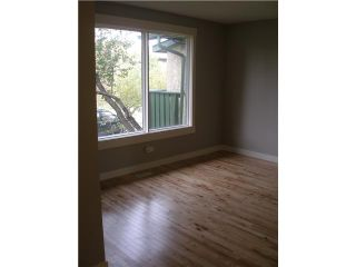 Photo 7: 228 MAUNSELL Close NE in CALGARY: East Mayland Heights Residential Attached for sale (Calgary)  : MLS®# C3445729