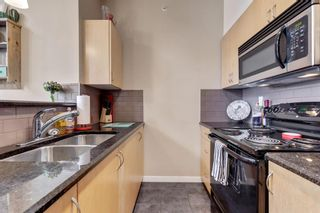 Photo 4: 1409 604 East Lake Boulevard NE: Airdrie Apartment for sale : MLS®# A1057063