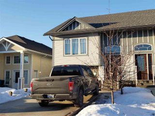 "Main Photo: 11006 104A Avenue in Fort St. John: Fort St. John - City NW 1/2 Duplex for sale in ""SUNSET RIDGE"" (Fort St. John (Zone 60))  : MLS®# R2550166"