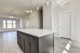 Photo 13: 132 Creekside Drive SW in Calgary: C-168 Semi Detached for sale : MLS®# A1144861