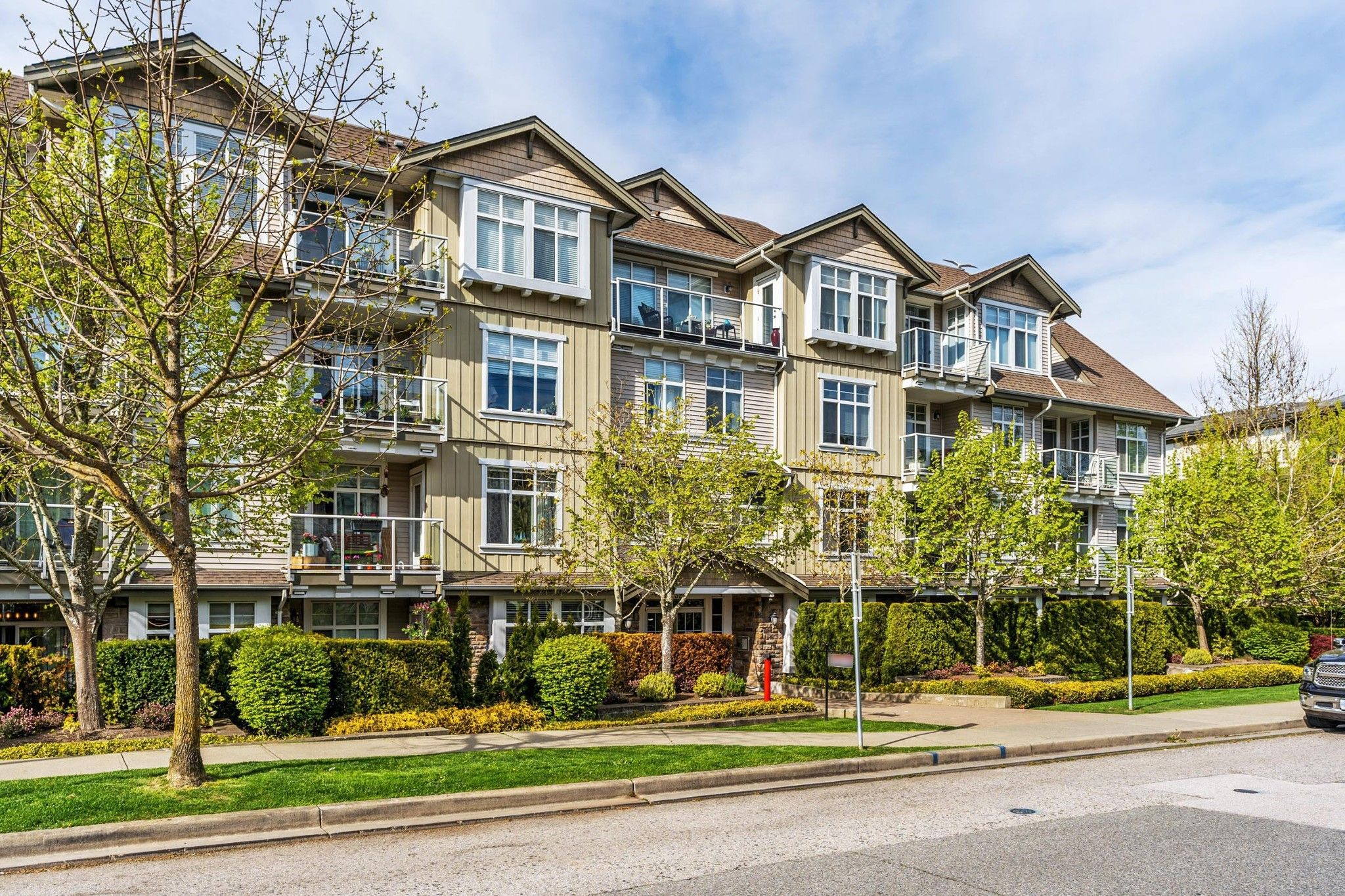 "Main Photo: 406 15323 17A Avenue in Surrey: King George Corridor Condo for sale in ""Semiahmoo Place"" (South Surrey White Rock)  : MLS®# R2571270"