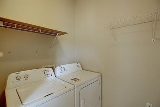 Photo 13: 8 12 Woodside Rise NW: Airdrie Row/Townhouse for sale : MLS®# A1108776