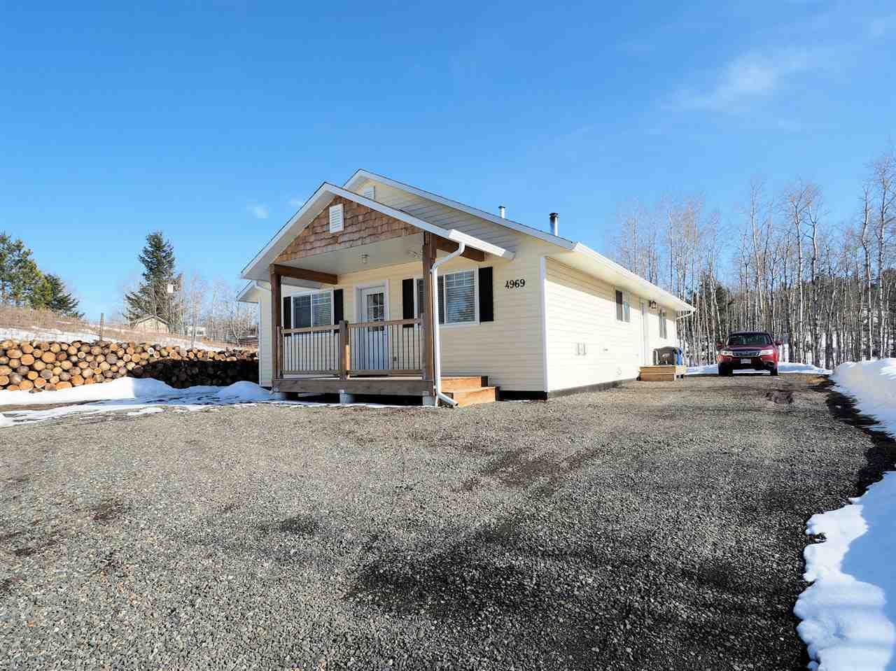 Main Photo: 4969 EASZEE Drive in 108 Mile Ranch: 108 Ranch House for sale (100 Mile House (Zone 10))  : MLS®# R2553061