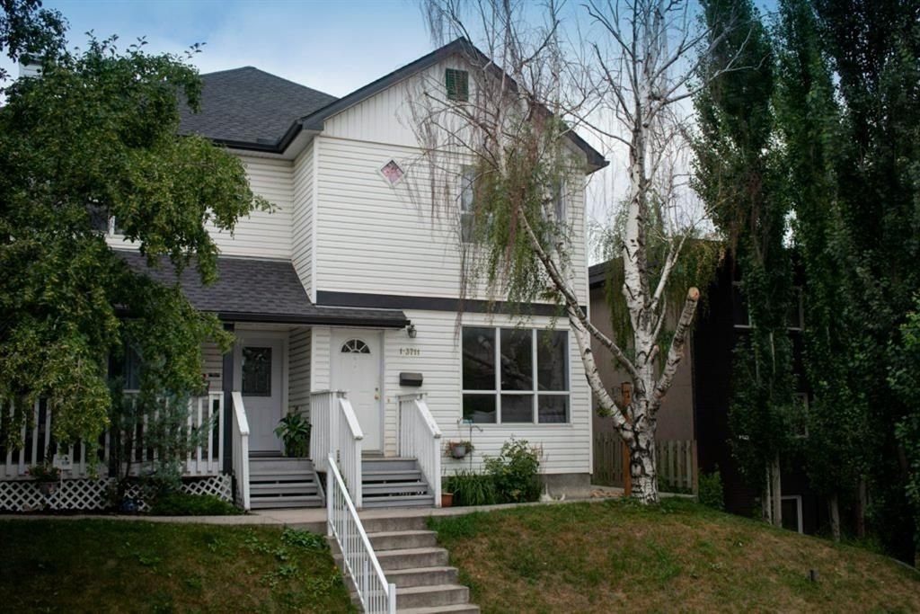 Main Photo: 2 3711 15A Street SW in Calgary: Altadore Row/Townhouse for sale : MLS®# A1138053