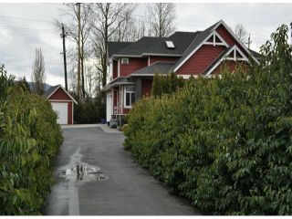 """Photo 2: 34814 1ST Avenue in Abbotsford: Poplar House for sale in """"Huntingdon"""" : MLS®# F1405409"""