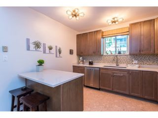 """Photo 9: 102 2733 ATLIN Place in Coquitlam: Coquitlam East Condo for sale in """"ATLIN COURT"""" : MLS®# R2475795"""