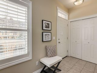 Photo 4: 81 Somme Boulevard SW in Calgary: Garrison Woods Residential for sale : MLS®# A1072185