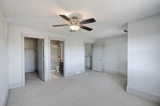 Photo 19: 63 Wentworth Common SW in Calgary: West Springs Row/Townhouse for sale : MLS®# A1124475