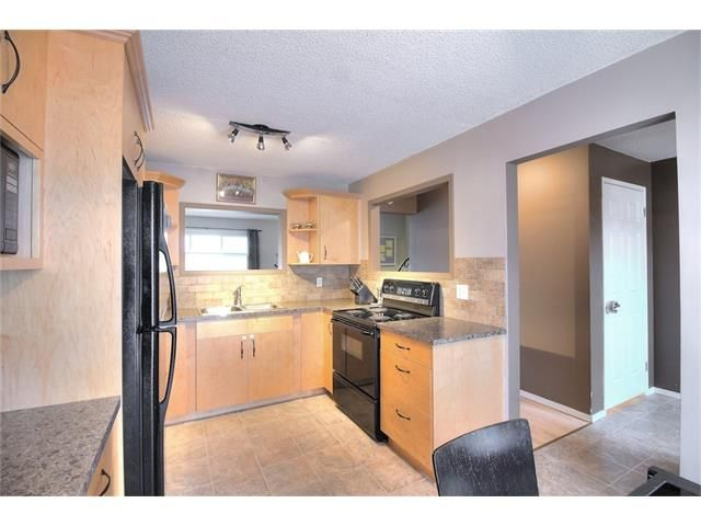 Photo 11: Photos: 108 SHAWGLEN Road SW in Calgary: Shawnessy House for sale : MLS®# C4038520