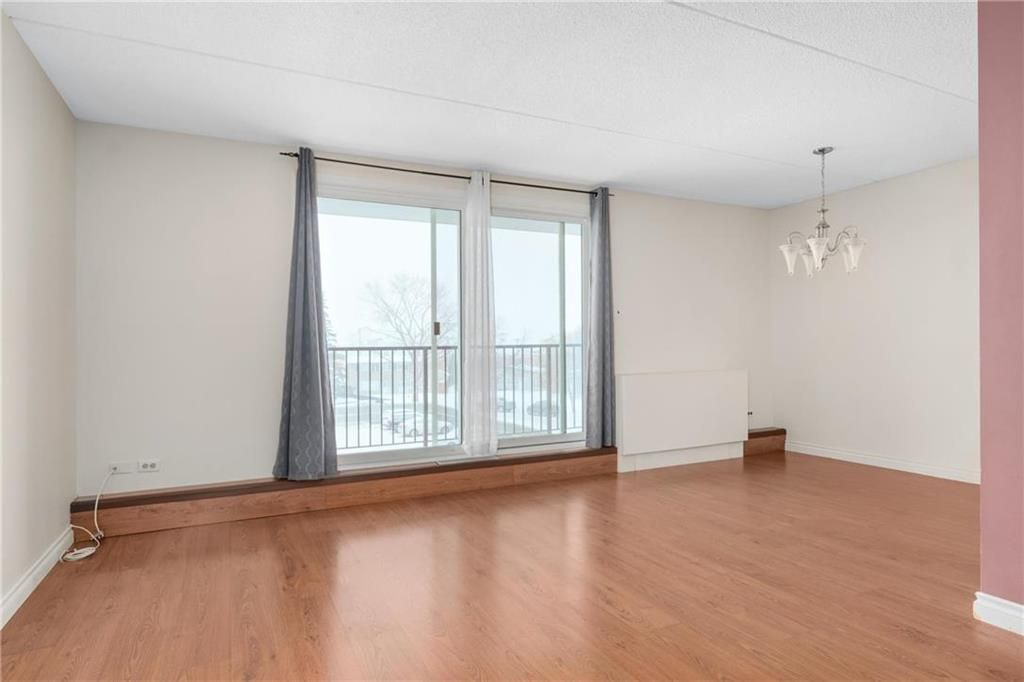 Photo 3: Photos: 309 1600 Taylor Avenue in Winnipeg: River Heights South Condominium for sale (1D)  : MLS®# 202101594
