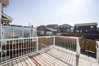 Photo 29: 122 Sunset Road: Cochrane Row/Townhouse for sale : MLS®# A1127717