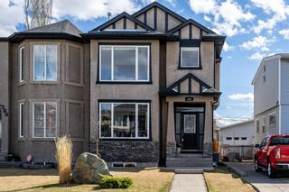 Photo 1: 419 26 Avenue NW in Calgary: Mount Pleasant Semi Detached for sale : MLS®# A1100742