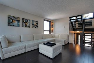Photo 1: 19 828 Coach Bluff CR SW in Calgary: Townhouse for sale : MLS®# C3604172