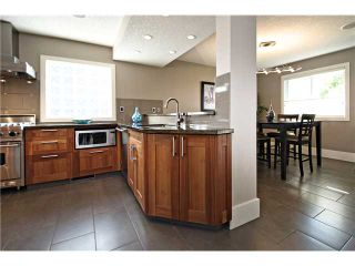 Photo 8: 3216 LANCASTER Way SW in Calgary: Lakeview House for sale : MLS®# C3654257