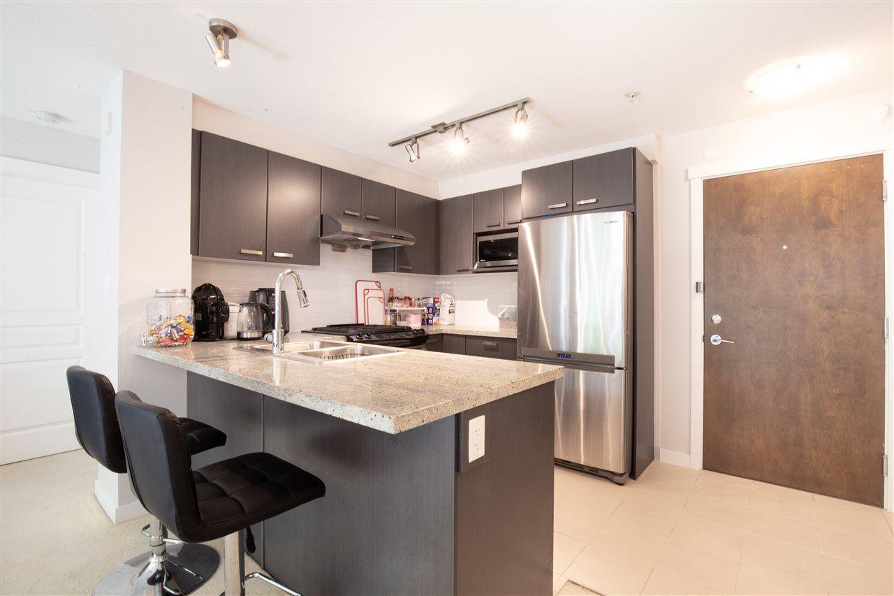 "Main Photo: 120 9399 TOMICKI Avenue in Richmond: West Cambie Condo for sale in ""CAMBRIDGE PARK"" : MLS®# R2486049"