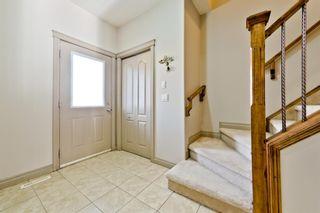 Photo 3: 984 Taradale Drive NE in Calgary: Taradale Detached for sale : MLS®# A1124450