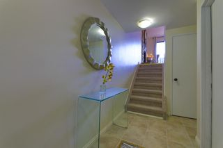 Photo 2: 1512 Ranchlands Road NW in Calgary: Ranchlands Row/Townhouse for sale : MLS®# A1112444