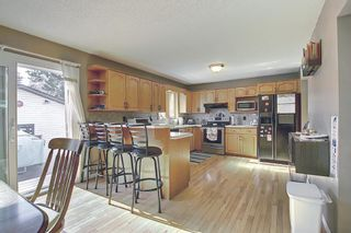 Photo 7: 12039 Candiac Road SW in Calgary: Canyon Meadows Detached for sale : MLS®# A1096218