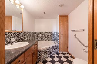 Photo 16: 214 7239 SIERRA MORENA Boulevard SW in Calgary: Signal Hill Apartment for sale : MLS®# C4282554