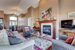 Photo 13: 206 GLENEAGLES View: Cochrane House for sale : MLS®# C4181281