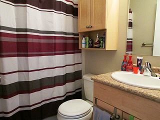 """Photo 7: 7916 97TH Avenue in Fort St. John: Fort St. John - City SE 1/2 Duplex for sale in """"NORTH ANNEOFIELD"""" (Fort St. John (Zone 60))  : MLS®# N234446"""