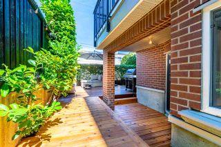 "Photo 2: 103 2239 W 1ST Avenue in Vancouver: Kitsilano Condo for sale in ""Ocean Gardens"" (Vancouver West)  : MLS®# R2567222"