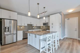 """Main Photo: 302 6490 194 Street in Surrey: Clayton Condo for sale in """"Waterstone"""" (Cloverdale)  : MLS®# R2603890"""