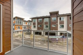 Photo 28: 268 Harvest Hills Way NE in Calgary: Harvest Hills Row/Townhouse for sale : MLS®# A1069741