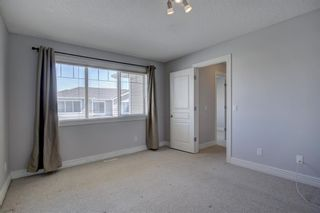 Photo 15: 76 Bridleridge Manor SW in Calgary: Bridlewood Row/Townhouse for sale : MLS®# A1106883