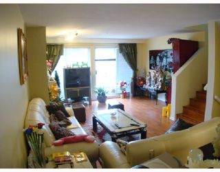 """Photo 2: 3457 AMBERLY Place in Vancouver: Champlain Heights Townhouse for sale in """"TIFFANY RIDGE"""" (Vancouver East)  : MLS®# V703168"""